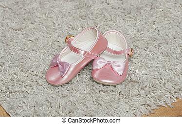 pink baby bootees macro