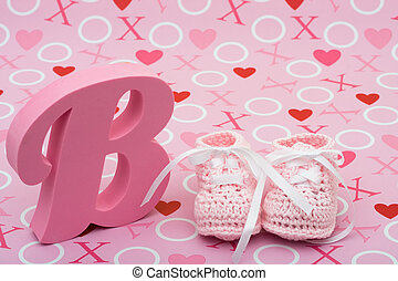 Pink Baby Booties - A pair of pink baby booties and the...
