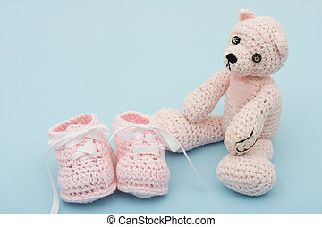 Pink Baby Booties - A pink handmade teddy bear and baby...