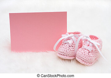 Pink Baby Booties - Baby booties with a blank card sitting...