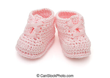 Pink Baby Booties - Handmade pink baby booties isolated on a...