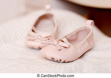 Pink baby booties on  background