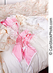 Pink baby-doll on bed - Messy bed with a sexy pink baby-doll