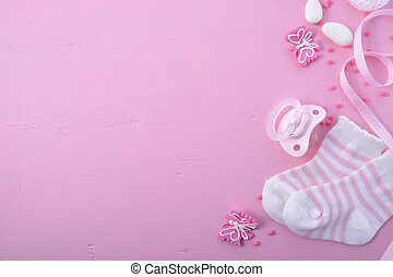 baby girl pink and white socks on pink background with baby shower