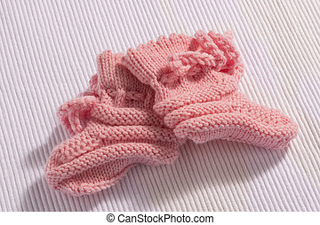 Pink baby socks on white background