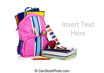 Pink backpack with school supplies with copy space - Pink...
