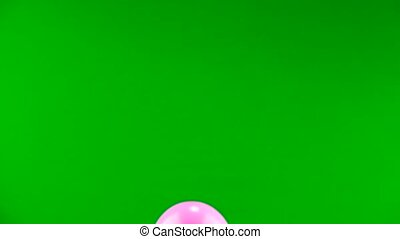 pink ball flies on the green screen