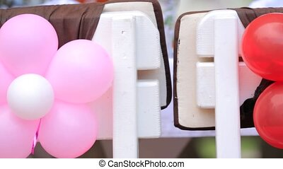 Pink Balloons Flowers Decorating Chairs Backs