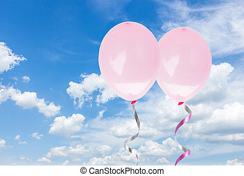 pink baloons in the sky