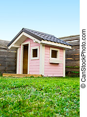 Pink beautiful House in a playground