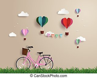 Pink bikes parked on the grass with heart shaped balloons floating on the sky. paper art and origami style.