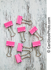 Pink Binder Paper Clips on White Wooden Background