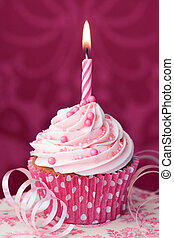 Pink birthday cupcake - Cupcake decorated with a single pink...