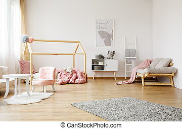 colorful kids room - Pink blanket on grey sofa in colorful ...