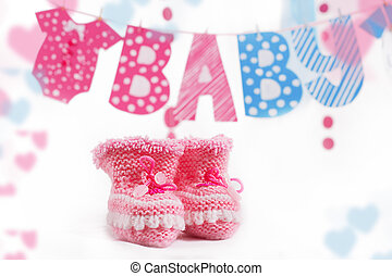 Pink bootees and baby word garland