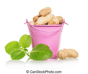 Pink bucket filled with unrefined peanut isolated on white
