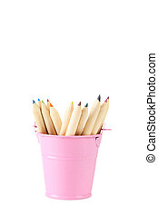 Pink bucket with pencils isolated on white