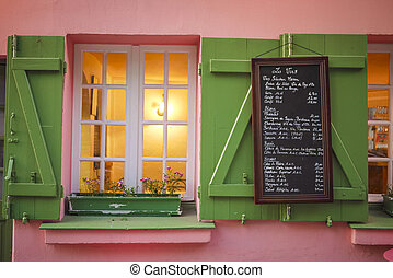 Pink cafe and menu board, Paris - Pink cafe, green shutters ...