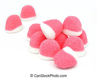 Pink sugary candies over white background