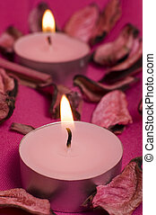 pink candles on violette decorated cloth,