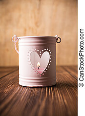 Pink candlestick. - Pink candlestick with heart shape.