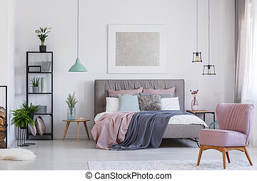 Pink chair in adorable bedroom