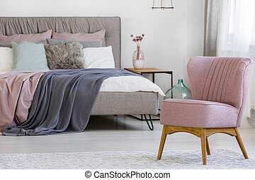 Pink chair in bedroom