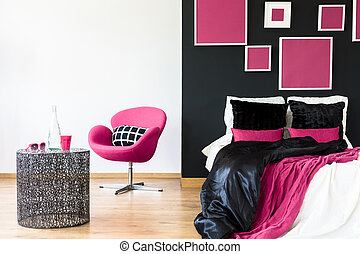 Pink chair in girly bedroom
