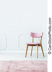 Pink chair in room