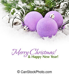 Pink christmas balls and fir branches with decorations on ...