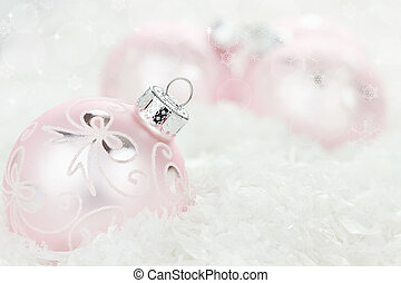 Pink Christmas Baubles - Pink Christmas baubles lying in the...