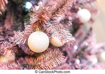 Pink Christmas tree with clasic holiday decoration