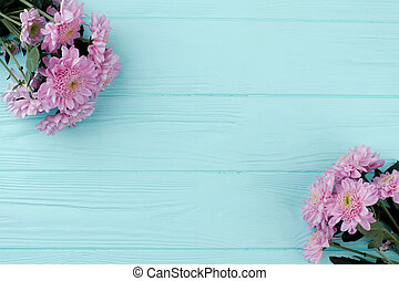 Pink chrysanthemums on wooden background.