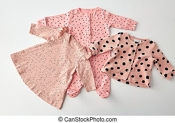 pink clothes for baby girl on white background