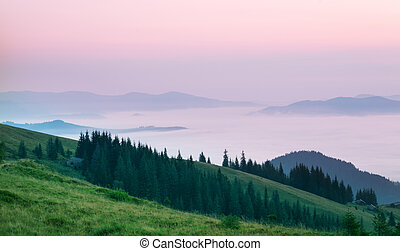 Pink clouds over the mountains in morning