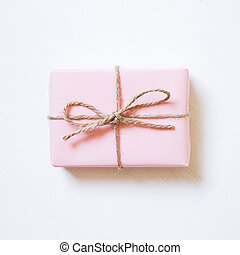 Pink color gift box on white background