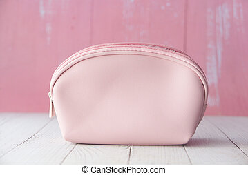 pink color women casual bag on wooden background