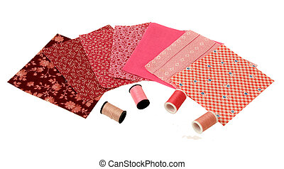 pink colored quilt squares with thread