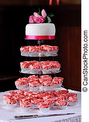 Pink cup cakes at wedding
