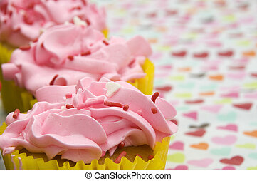 Pink Cupcakes with Hearts Background