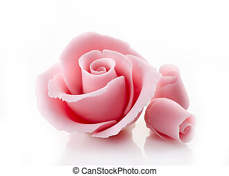pink decorative sugar rose on a white background
