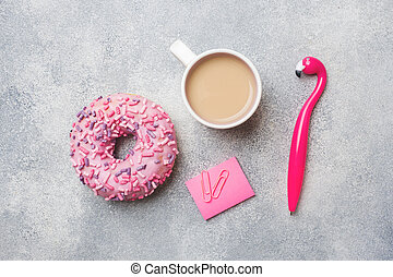 Pink doughnut and Cup of coffee Flamingo pen on a grey background. Top view Flat lay.