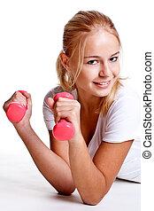 pink dumbbells in the hands of women