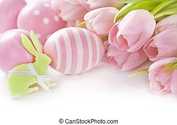 Pink easter eggs and tulips