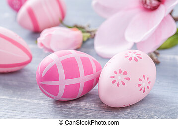 Pink easter eggs on a blue wooden background