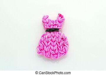 Pink elastic rainbow loom bands dress shaped on white...