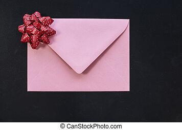 Pink envelope on black background