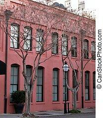 Pink facade, trees and street lantern in Charleston, South Carolina, USA