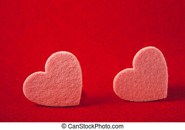 pink felt hearts on red background, valentine's day