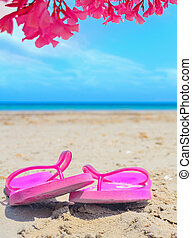 pink flip flops under colorful oleanders